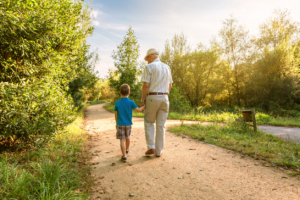 Active Transportation Leads to a Healthy Community - Grandpa and Grandson Walking